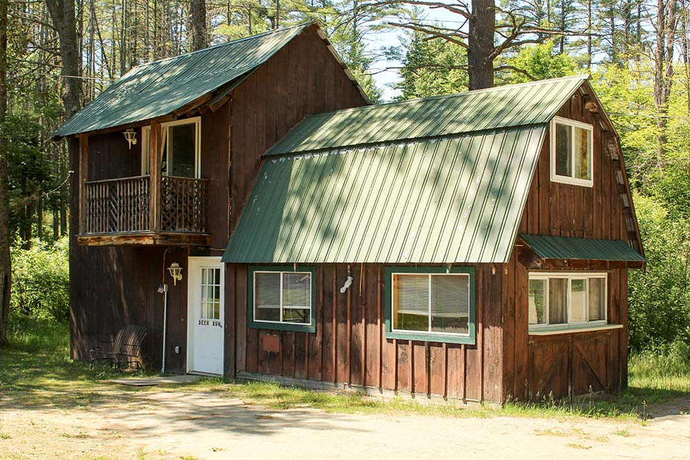 2 story cabin with wood siding