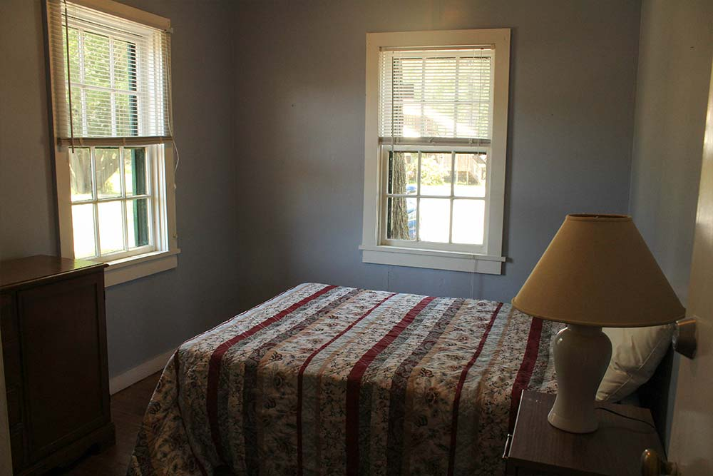 Bedroom with bed and 2 windows