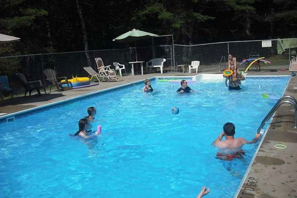 Pool with people playing games