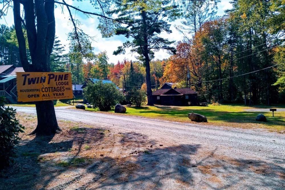 Entrance sign on dirt road